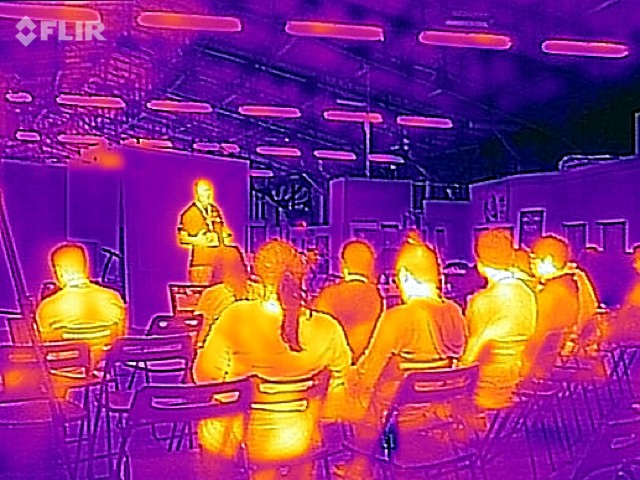 Thermal image of an audience and speaker