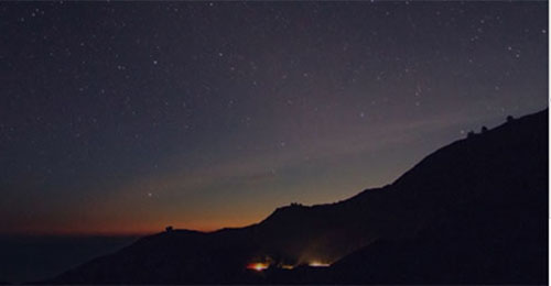 Banner image of hill and night sky